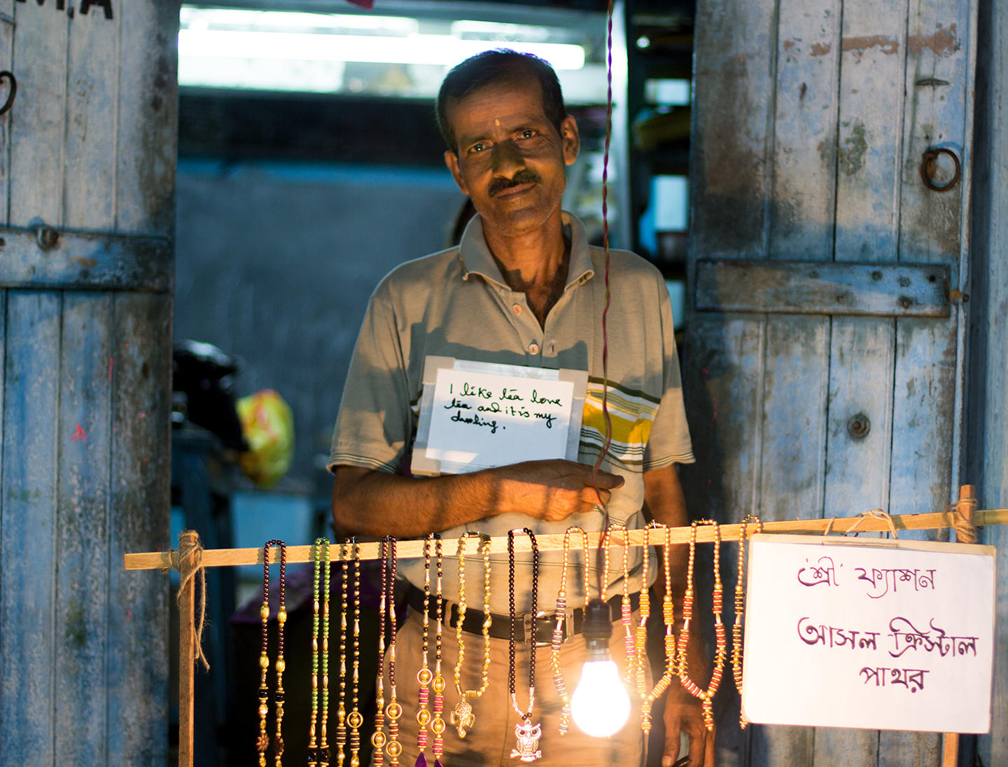 Subankha sells jewelry made by his wife in Kolkata's Kalighat Market. He also writes stories that he self publishes as hard cover books. Chai gives him energy and inspiration.