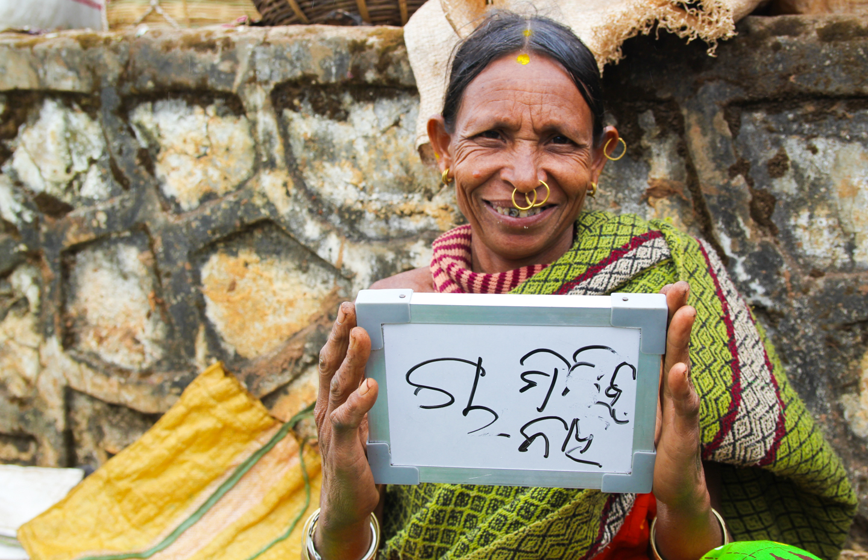 Nani, an Adivasi tribal woman in Orissa's Damanjodi village, sells peppers and radish at her sidewalk stand, but not chai.