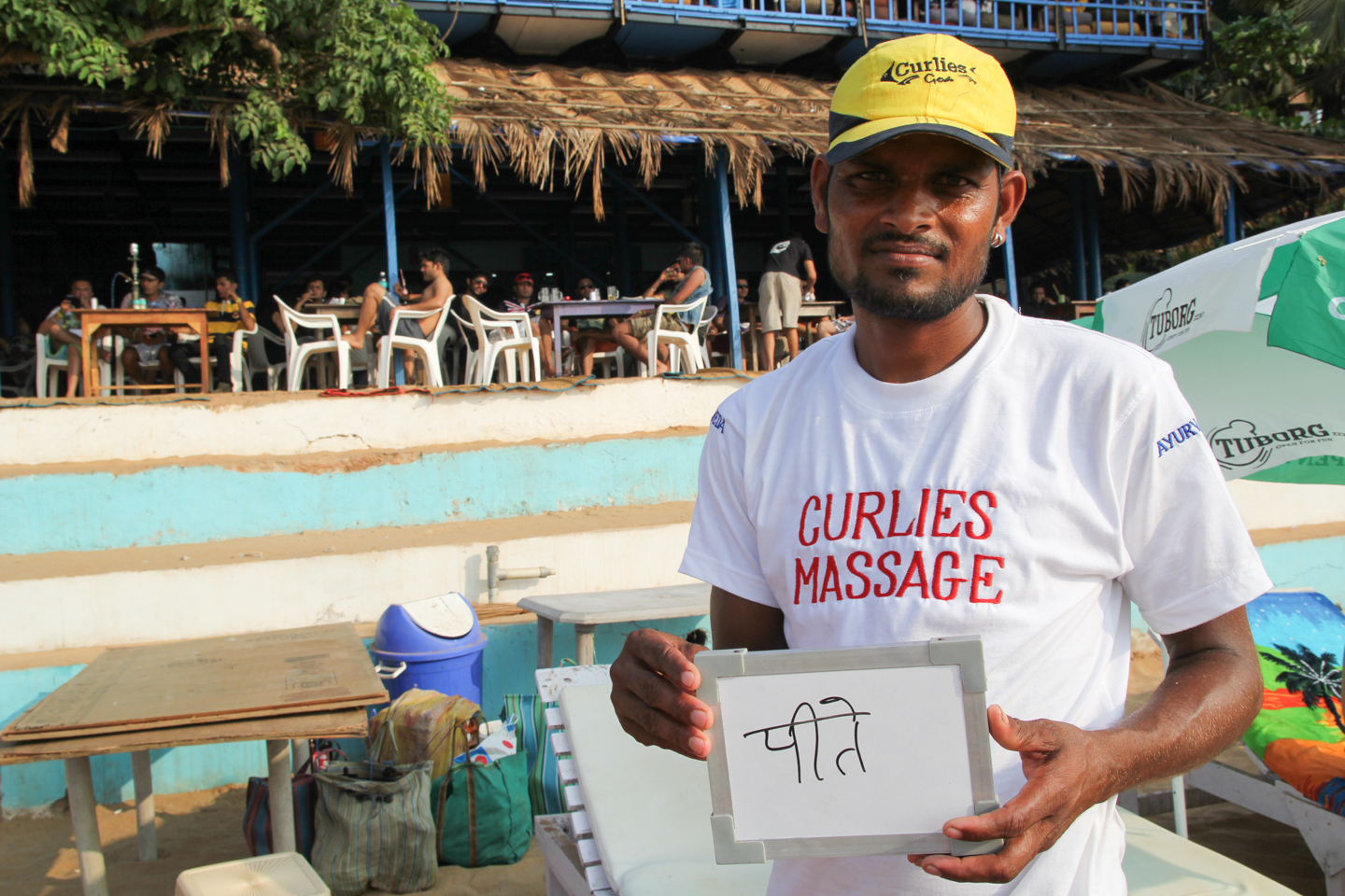 Manju left his village in Madhya Pradesh for the beaches in Goa. He works at one of Anjuna's most famous oceanside shacks, Curlies, where he is an official masseur.