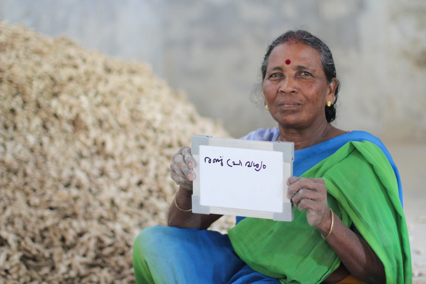 Bebi works at the Ginger Palace in Fort Kochi, where she sorts giant mounds of dried ginger root into piles of larger and smaller pieces for export. She drinks chai two times a day - once at 10 am and once at 4:30 pm.