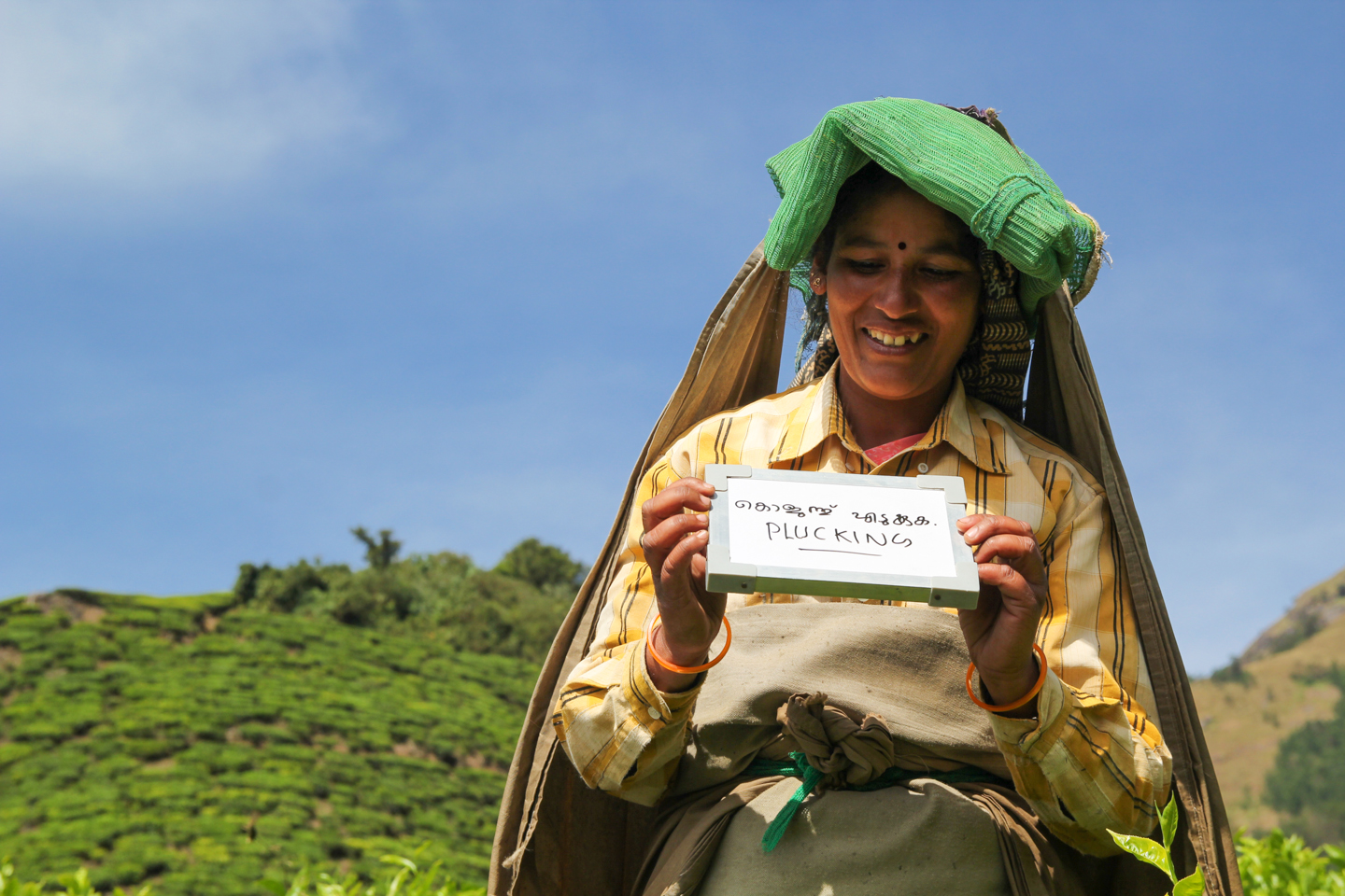 Born and brought up on Surianalle tea estate in the hills of Kerala, Delma plucks tea leaves eight hours a day. Delma had a love marriage with a man who works at the tea estate's processing factory where the leaves are turned into tea dust destined for the chai stands of India.