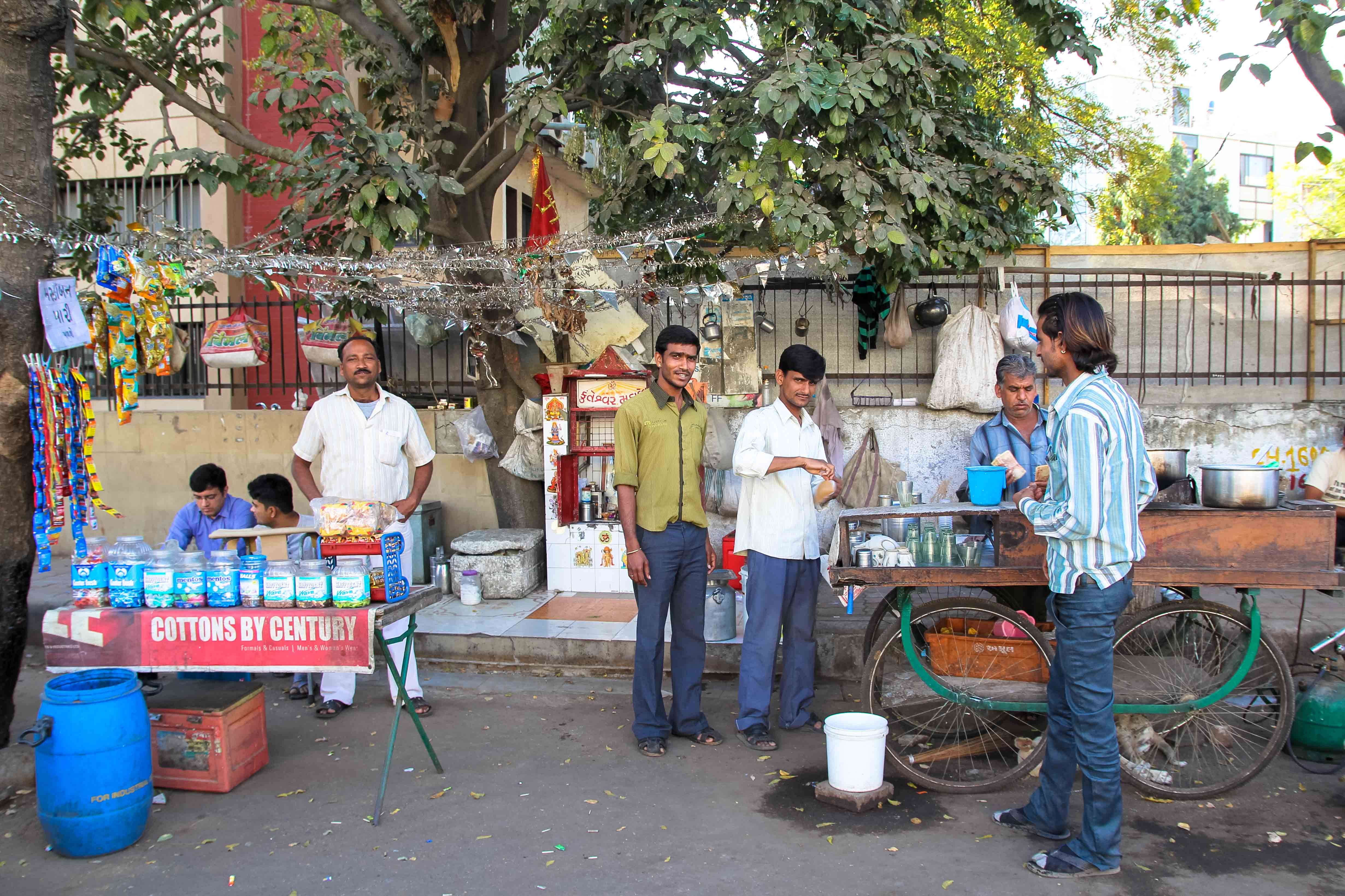 For the Rajputs, chai is a family business. Pictured left to right: Manu Singh, Ganesh, Devraj and Bharat Bhai serve customers near Ahmedabad's Law Garden.