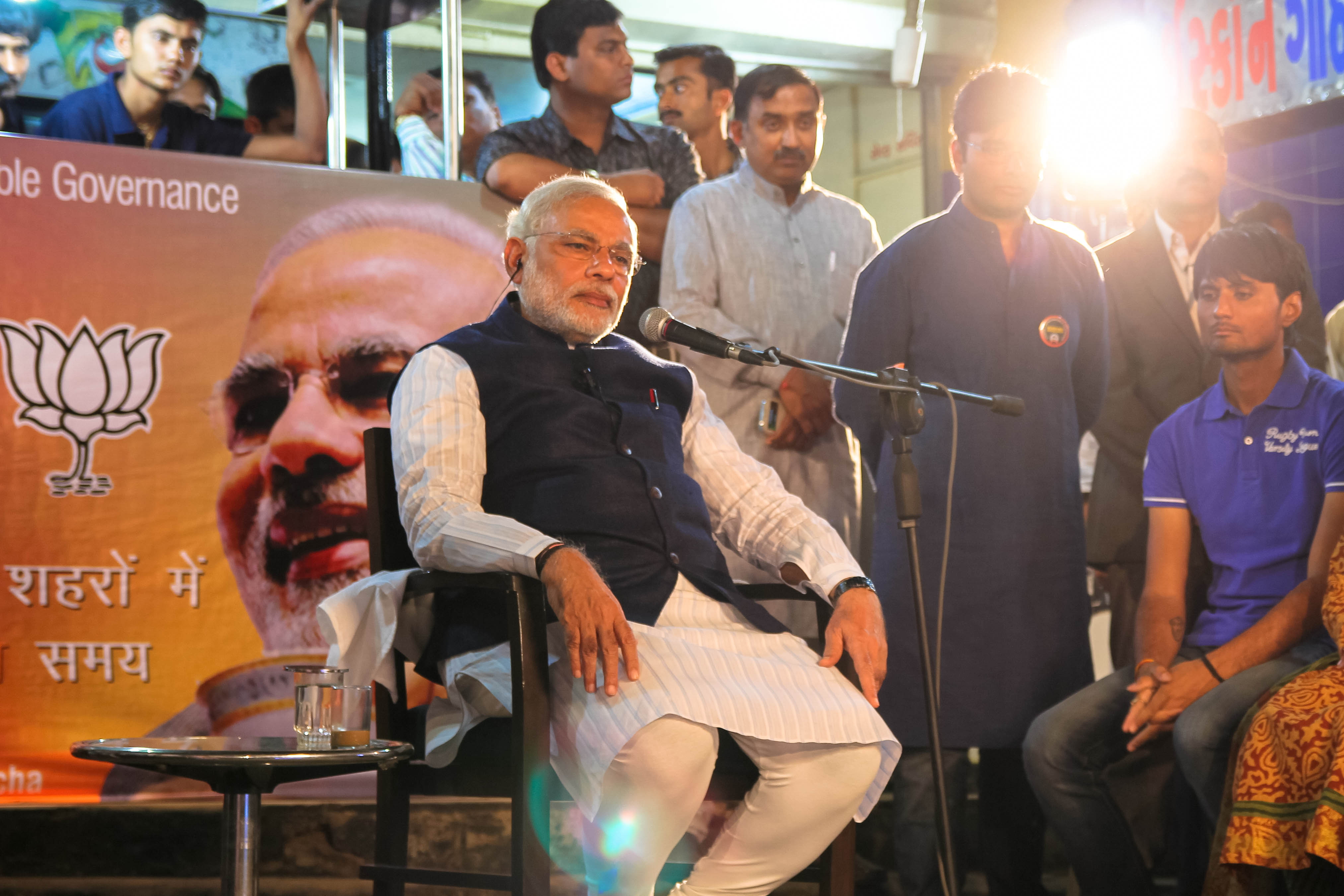Rajesh Giri Meghnathi, the chai wallah who made the tea served to Modi, was in the background (left) for the Chai Pe Charcha, while Modi and the chai were in the foreground.