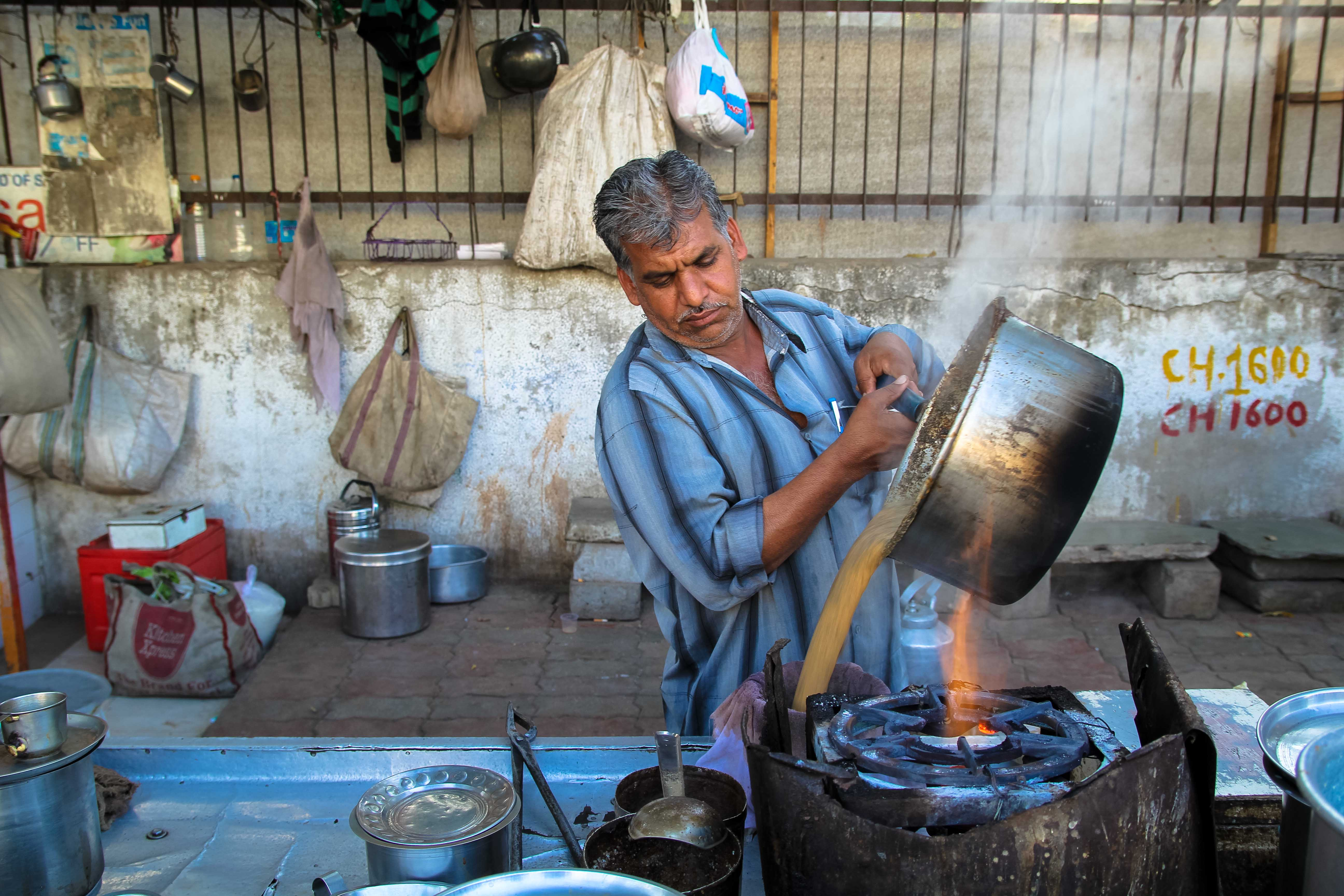 Bharat Bhai strains a pot of his special cardamom chai.