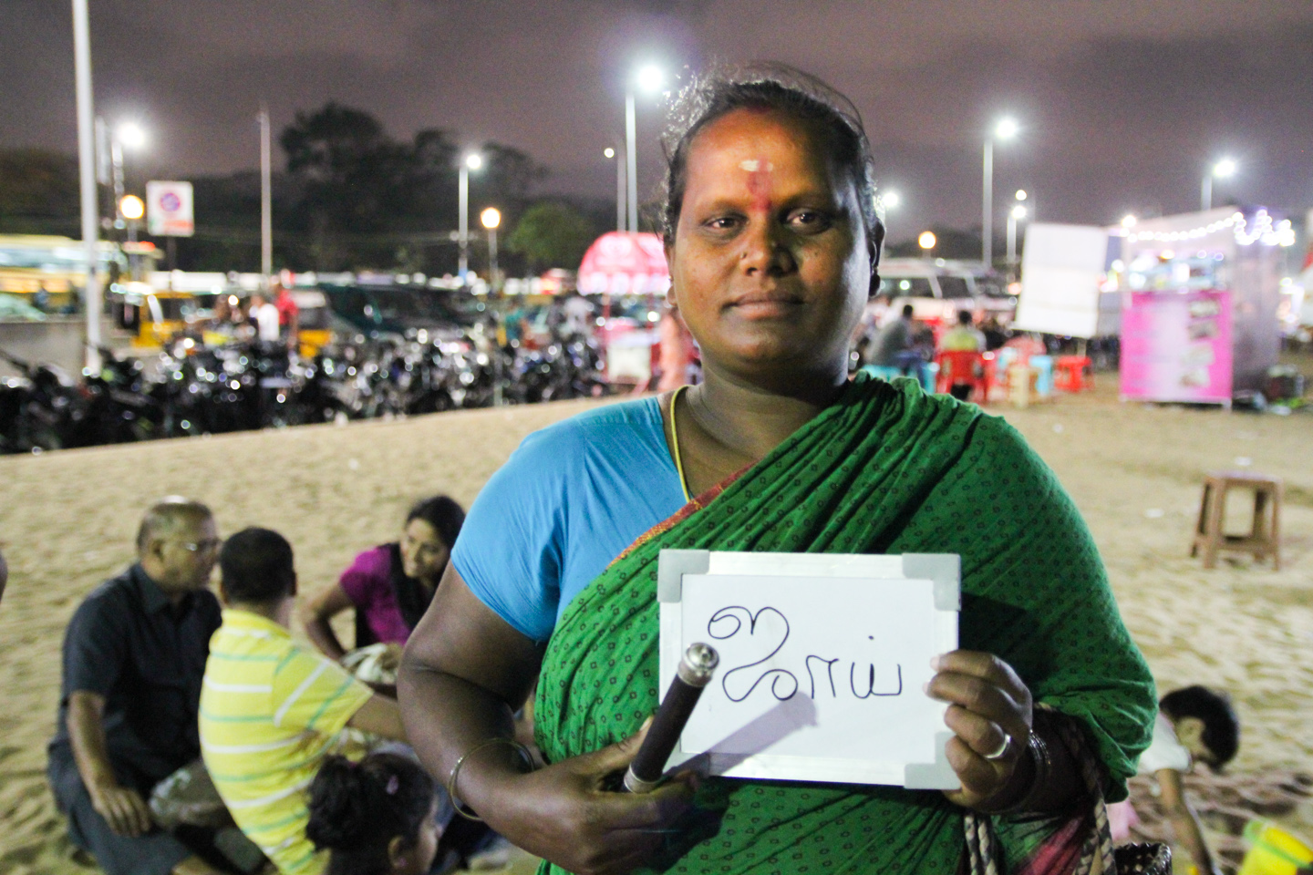 Laxmi has been telling fortunes on Chennai's Marina Beach for 45 years. Her whole family is in the profession, but her daughter Megla goes to school and will not be continuing the tradition when she grows up.