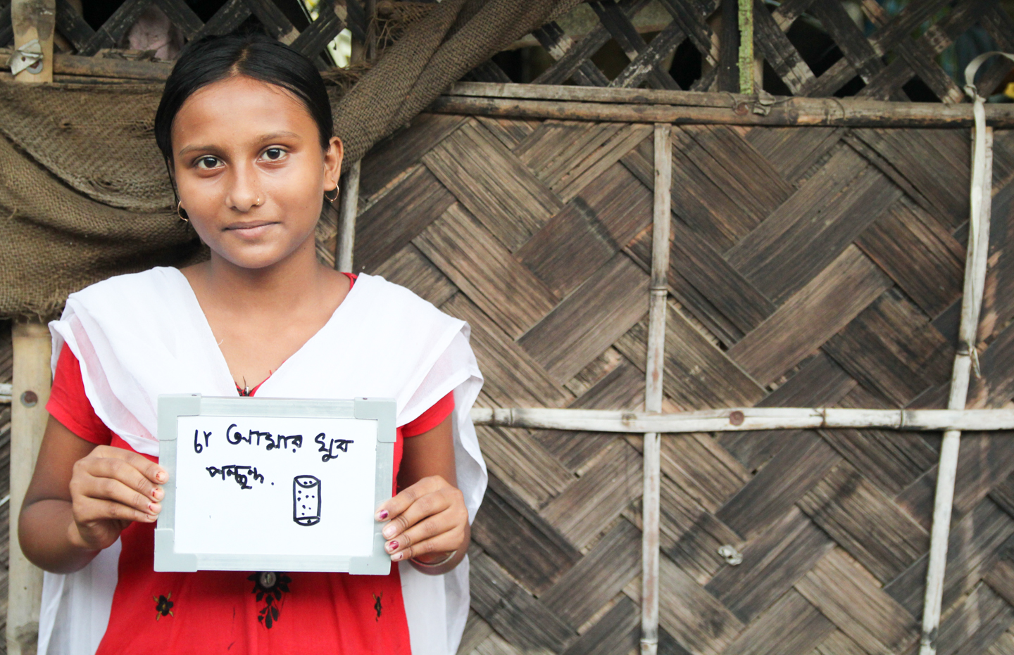 Riya lives in Bonharishpur, a small village in West Bengal. Although there are several chai wallahs in the village whose stands are hubs of activity, Riya, an eighth grader, prefers to drink her mother's special tea at home.