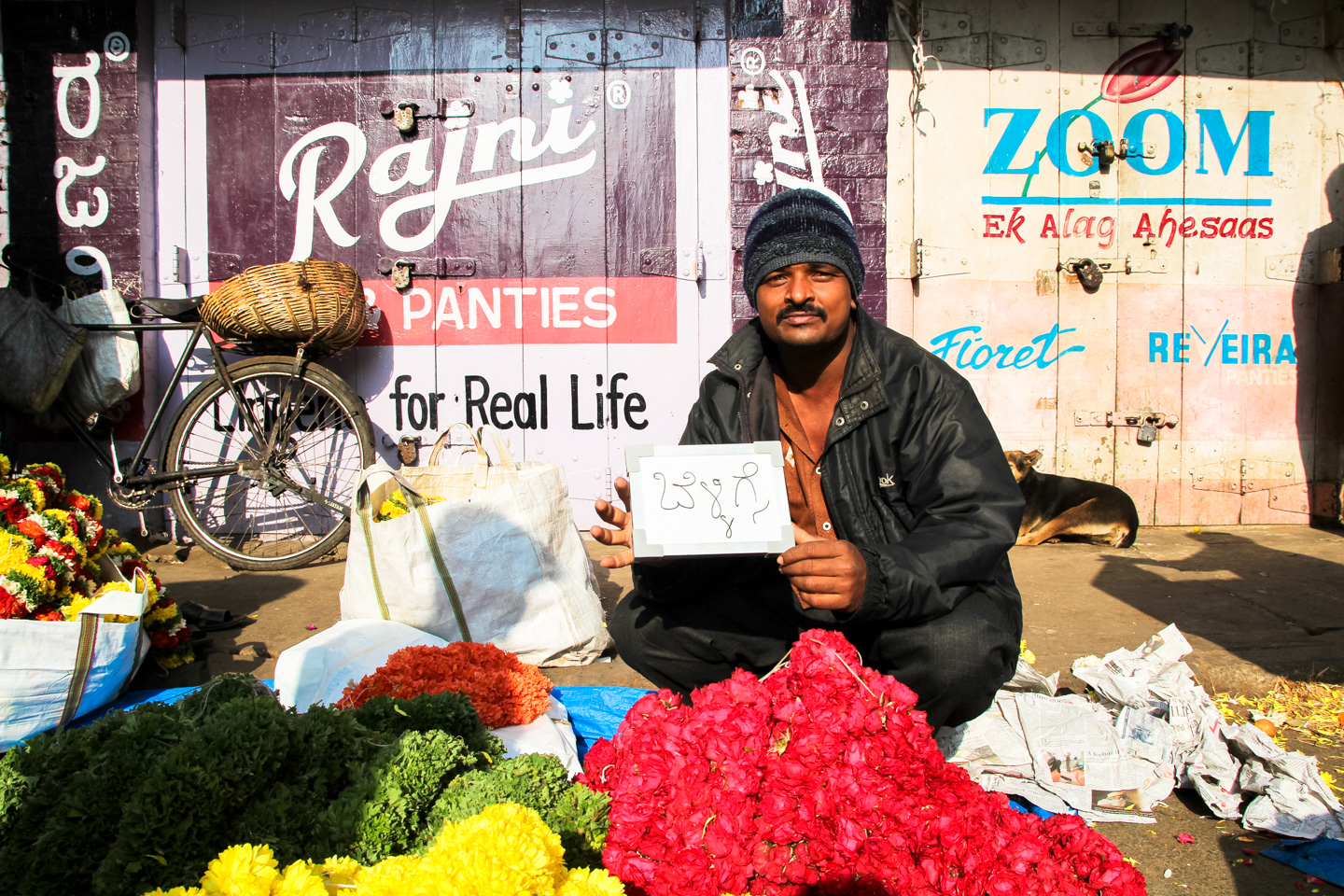 Raj has been selling flowers in Bangalore's City Market, or KR Market, for ten years. He drinks chai every morning while setting up his stand.