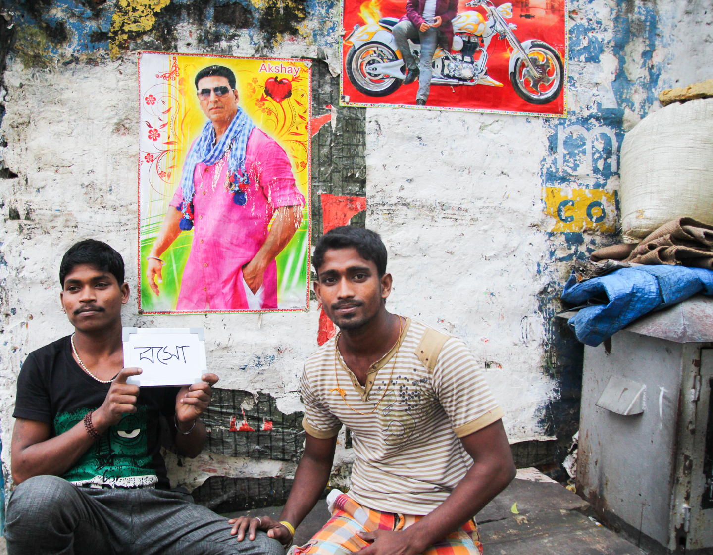 Bablu Pal, right, and his best friend always enjoy their cups of chai sitting under a poster of Akshay Kumar, one of their favorite film heroes in Kalighat, Kolkata. Bablu's father and uncle are potters who make the clay cups, known as 'bhar' in Bengali, in which chai is consumed throughout the city.