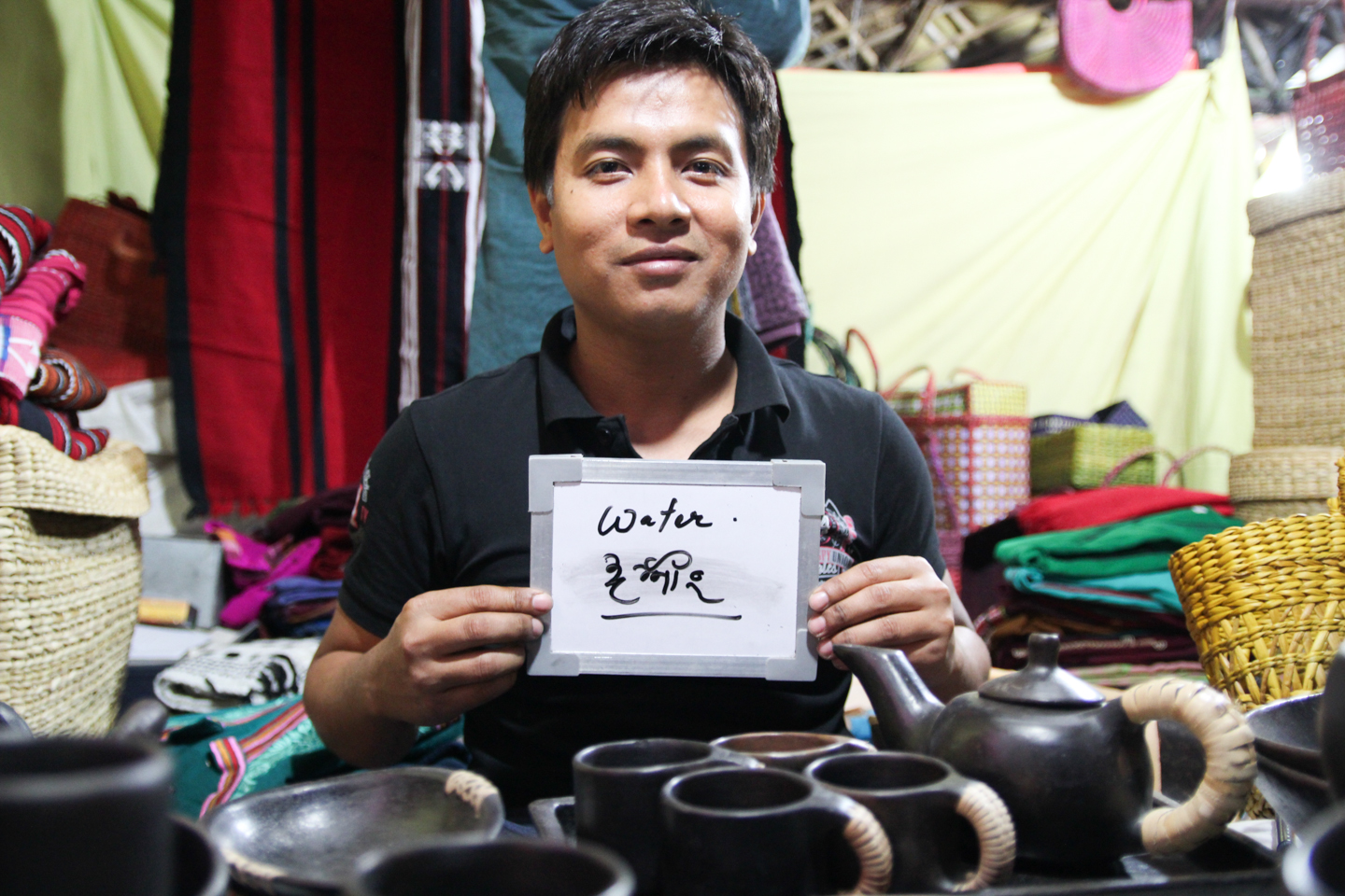 James sells handcrafted tea kettles and cups from his home state of Manipur at Dilli Haat in Delhi. The vessels are made from serpentinite rock, which is fireproof and supposedly imparts health benefits into the brew inside the pot.