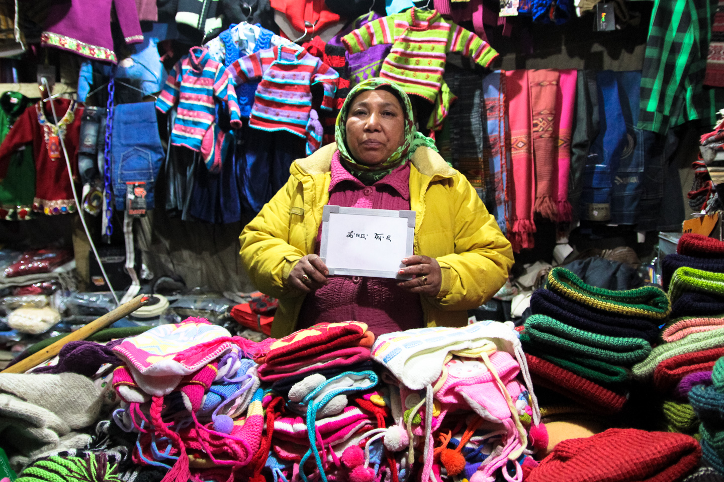 Tsering Dolma sells hats and gloves made of yak wool, along with some imported winter clothes from China, in Leh's main market. She drinks salty tea throughout the day to stay warm.