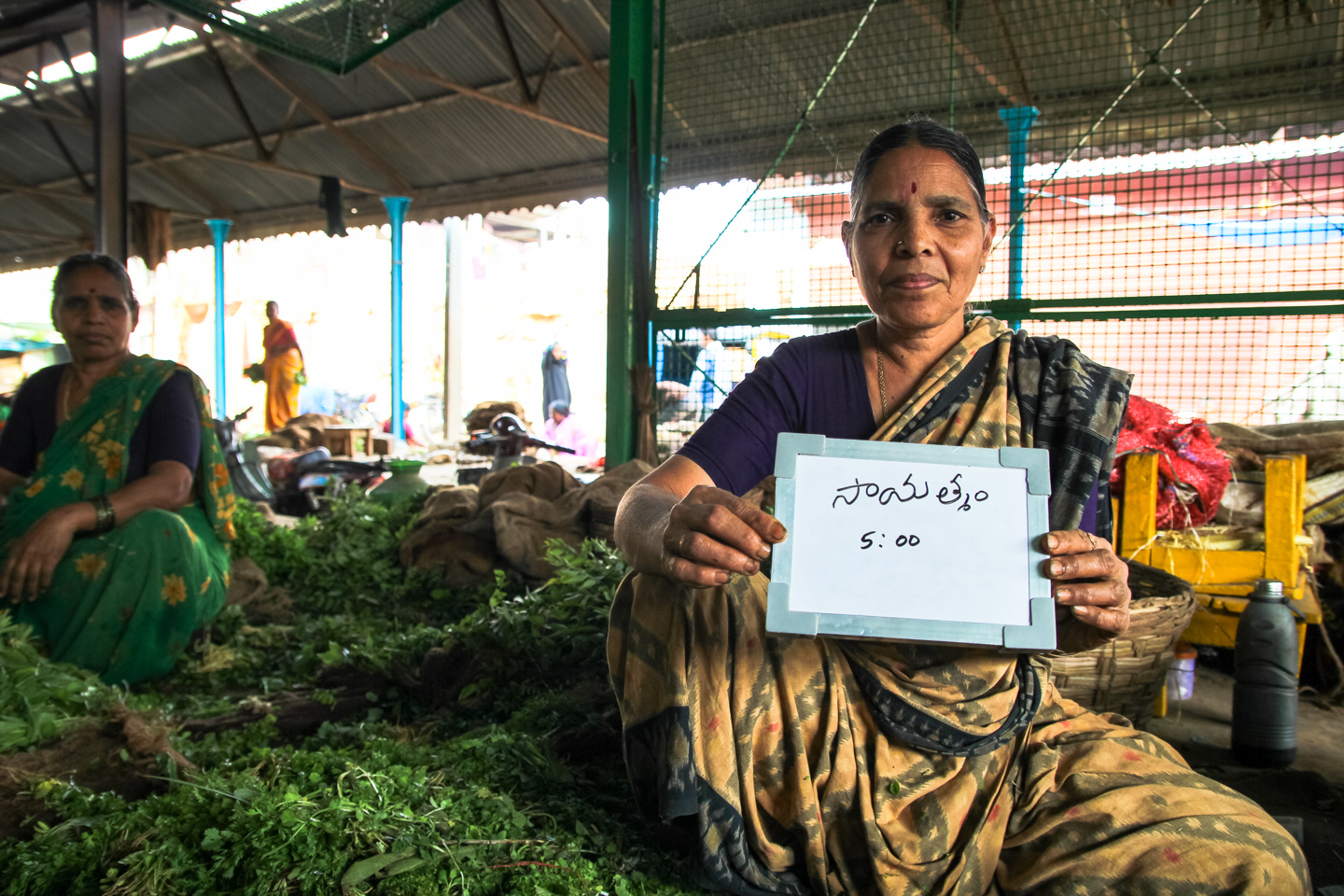 Lalita sells mint and cilantro at a vegetable market near Charminar, Hyderabad. Her two daughters live in the United States, and when they come back to visit, they join Lalita on her daily 5 pm chai break.