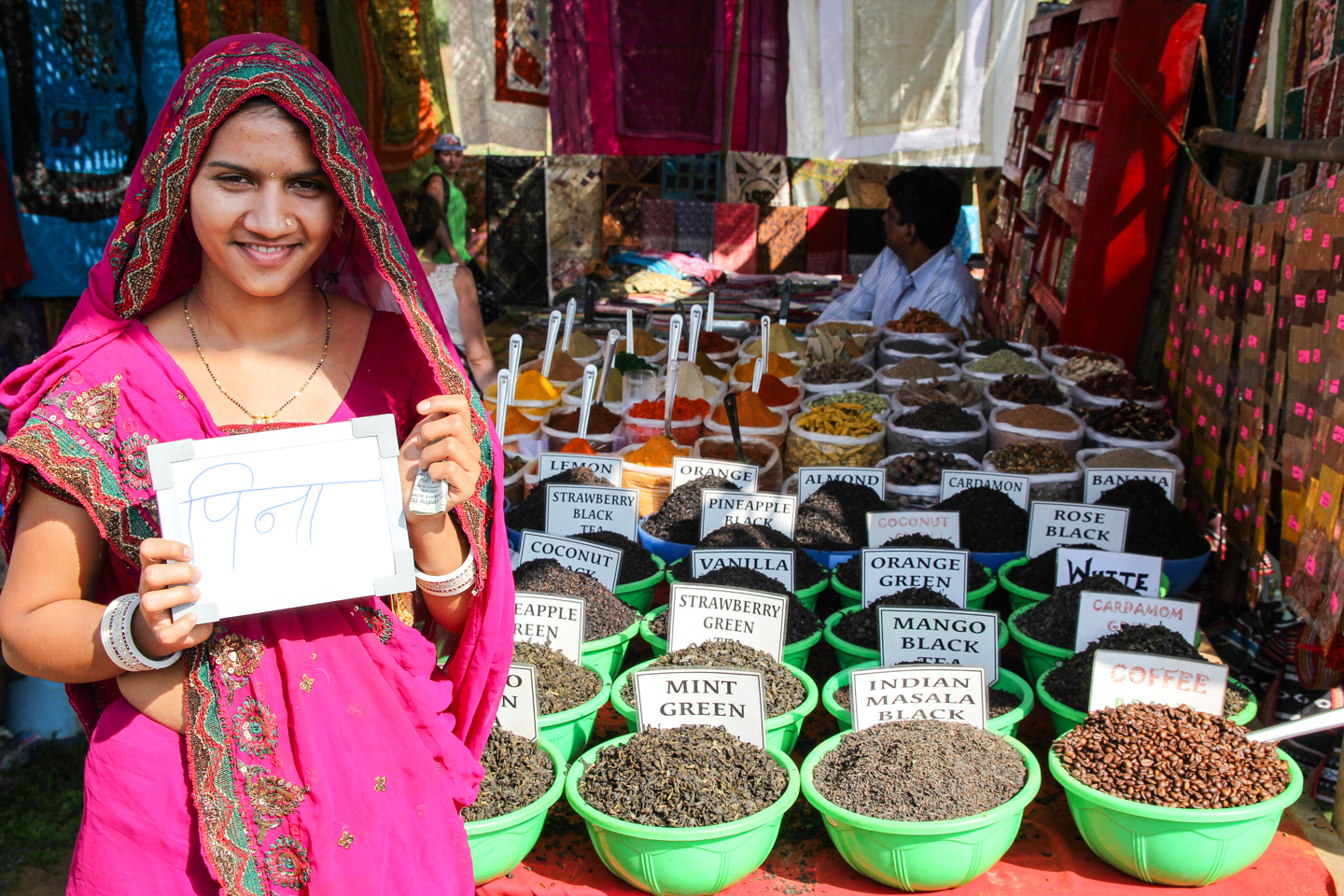 Manju, originally from Gujarat, sells tea and spices at Anjuna Market in Goa. She encourages the tourists who visit her stall to drink green tea for 'health reasons.'